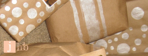 Gifts wrapped in kraft paper and painted